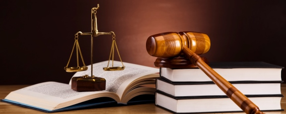 Photo of law books, gavel and balance