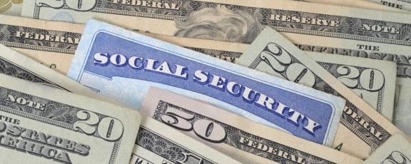 Photo of Social Security Card on table with dollar bills